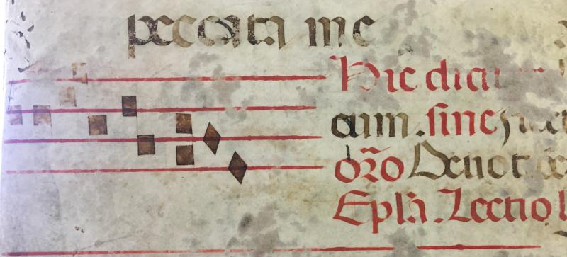 Riutilizzo di una pergamena con tetragramma come copertina di atti notarili - metà XVII sec.